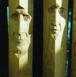 Oak post people 2 from a set of 9 carved for a railing on a loft.