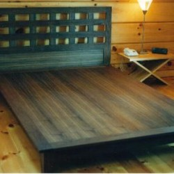 Walnut platform bed with removable headboard.