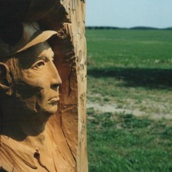 Field of dreams carved from a 100 year old barn beam.